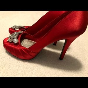 .Brand New (Floor Model) Gorgeous Heels By FIONI